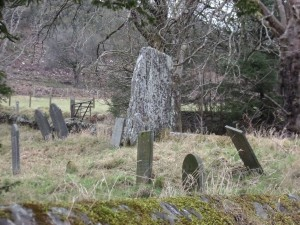 An old stone amongst the headstones